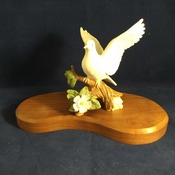 Porcelain Dove Figurine on wood base